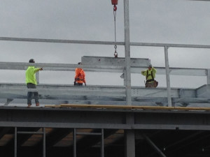 Lowering the Last Beam into Place